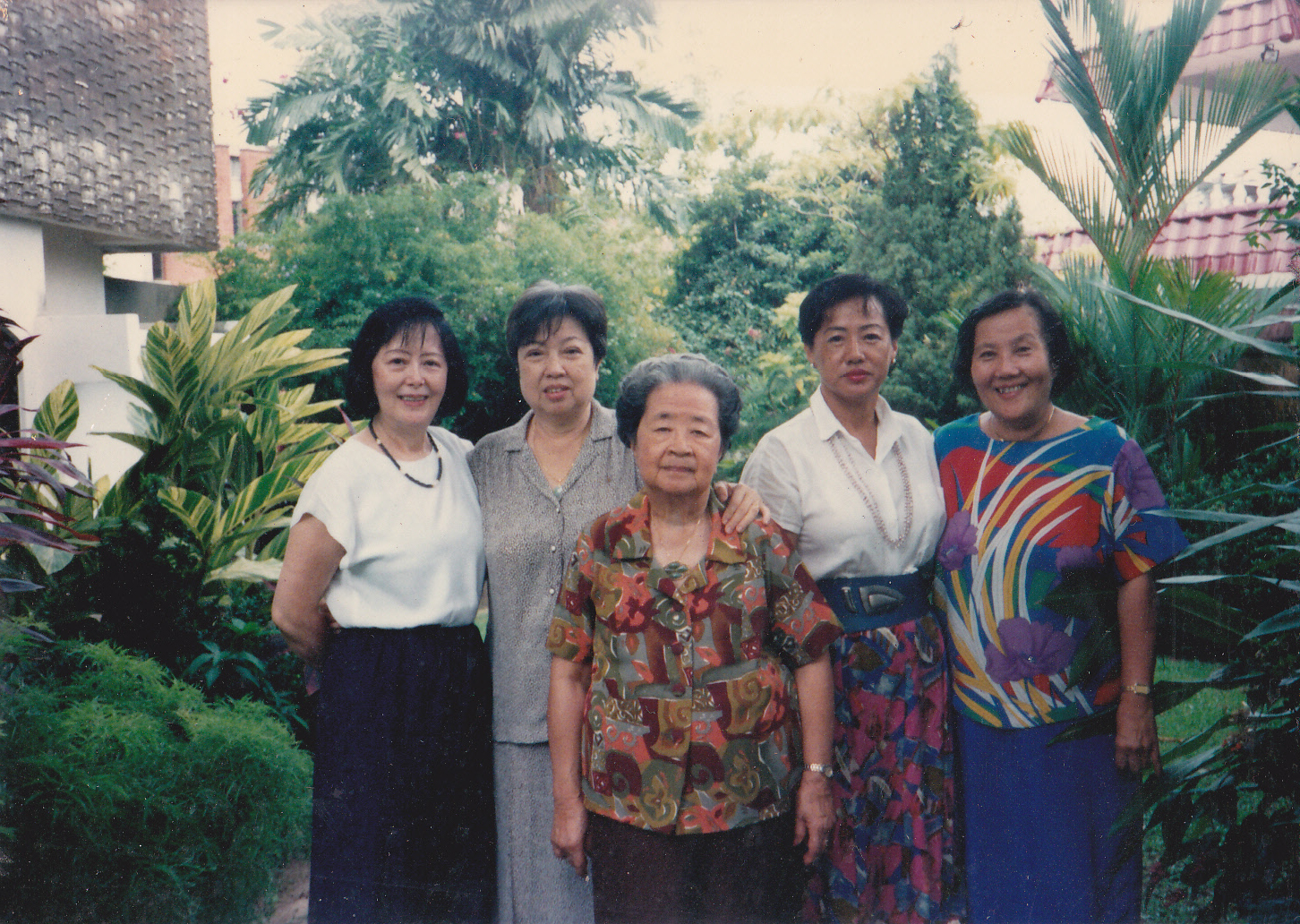 Ginny (second from right) mingled with Singapore's most influential elites. At the centre of the picture is Singapore's President Tony Tan's mother.